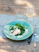 Poached chicken breast with lemon sauce and spinach