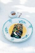 Wolffish with basil puree wrapped in aubergine