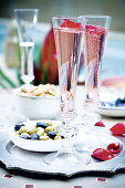 Prosecco with rose petals