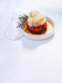 An aubergine and tomato tower with caramelised mozzarella