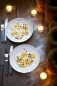 Scallop carpaccio with black pudding crumbs for Christmas