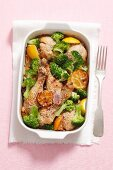 Chicken legs with lemon, broccoli and sesame seeds