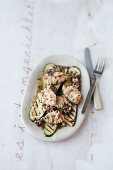 Calamaretti on a bed of grilled courgettes