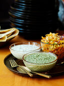 Indian side dishes: walnut and mint chutney, raita and carrot salad