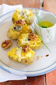 Baked potatoes filled with sauerkraut and blue cheese and served with butter sauce