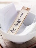 A label with the words 'be inspired' written on it in a bowl