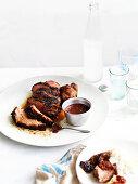 Isann cuisine: Muu yang (grilled pork) with nam jim jaew (chilli dip)