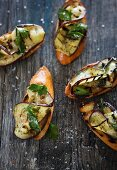 Crostini alla melanzana (toasted bread topped with aubergine and mint)