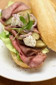 Roast beef, gherkins and remoulade on a baguette