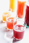 Various types of juice in bottles and glasses