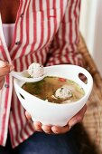 Clear broth with chicken dumplings (Asia)