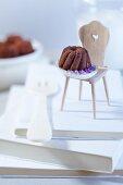 A mini Bundt cake praline with purple sugar