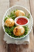 Boiled eggs marinated in tea on a bed of cress (China)