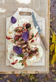 Grilled unleavened bread with caramelised chicken, mushrooms and red basil