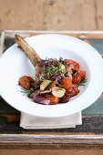 Braised leg of lamb with a tomato ragout