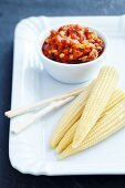 Corn cobs with a tomato dip