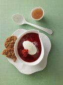 Red berry jelly soup with buttermilk dumplings and oat biscuits