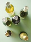Various bottles of wine and a champagne bottle seen from above