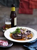 Wagyu beef steak with mushrooms and radishes