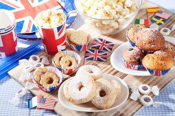 Cakes, popcorn and sweets for an international party