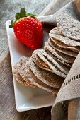 Schüttelbrot (crispy unleavened bread from South Tyrol) and a strawberry