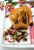 Gingerbread in a paper bag with star anise, cinnamon sticks and St. John's wort
