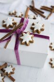 Cinnamon stars on a gift box tied with a velvet ribbon