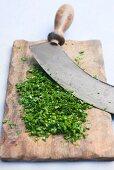 Freshly chopped herbs on cutting board
