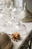Assorted vintage-style glass domes on an old stone tabletop