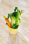 Bok choy and carrots in a wafer cone
