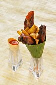 Spare ribs with potato wedges and a tomato dip