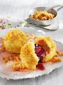 Damson dumplings with butter crumbs