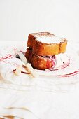 Blackberry and Mascarpone Stuffed French Toast Made with Brioche; On a Plate with Knife and Fork