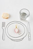 Place setting with half a radish and a small piece of bread