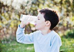 A little boy drinking a glass of milk