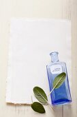 Sage leaves and a blue apothecary bottle