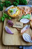 A mini quiche with shallots and celery