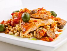 Sauteéd Veal Cutlets Served with Israeli Couscous, Caper Berries, Green Italian Olives, Olive Oil and Pan Juices