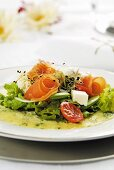 Smoked salmon salad on herb pancakes
