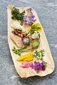 Annual honesty flowers and other vegetables with a trio of dips