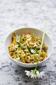 Fried rice with vegetables and ramson flowers