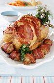 Bacon-wrapped roast turkey joint