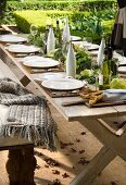 A wooden table, decorated for autumn, outdoors