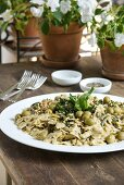 Farfalle with olives, courgette and anchovies