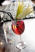 An Oriental cherry drink with a white lily flower