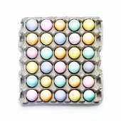 Many Colored Eggs in a Cardboard Carton; From Above
