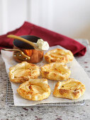 Small apple tarts on baking paper