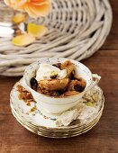 An apple dessert with granola in a teacup