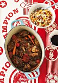 Oxtail stew with a flaked corn and vegetable salad (South Africa)