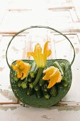 Courgettes with courgette flowers in a basket